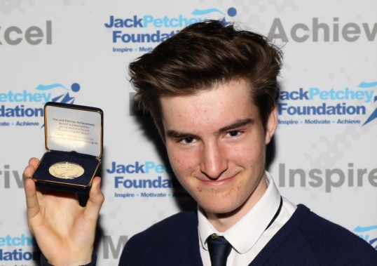Young person wins Achievement Award for breaking a flying record!