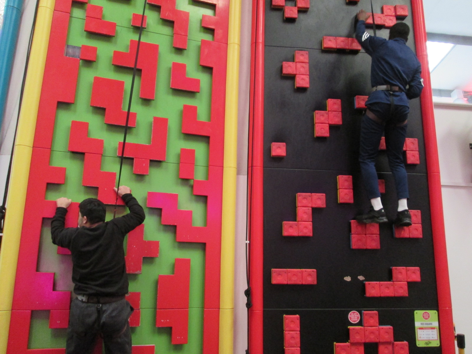 Students work together to climb obstacles!